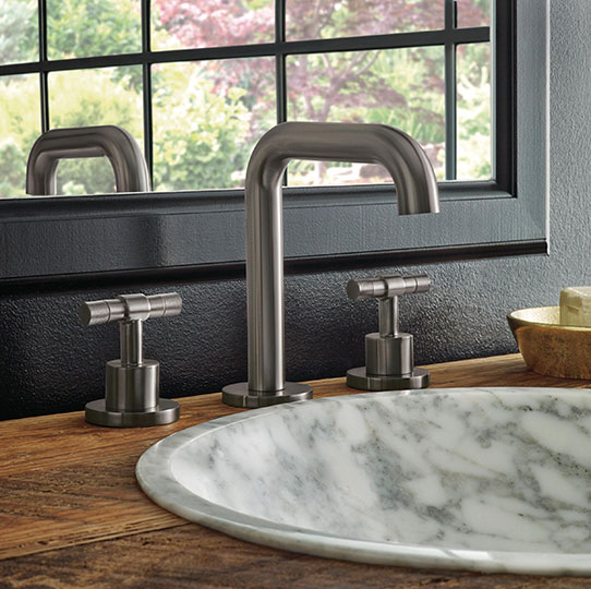 Contemporary Brizo faucet with marble sink and wooden vanity