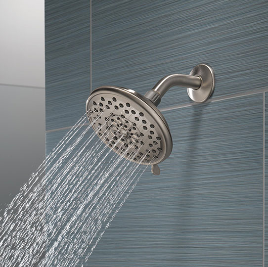 Closeup of Peerless showerhead with blue background